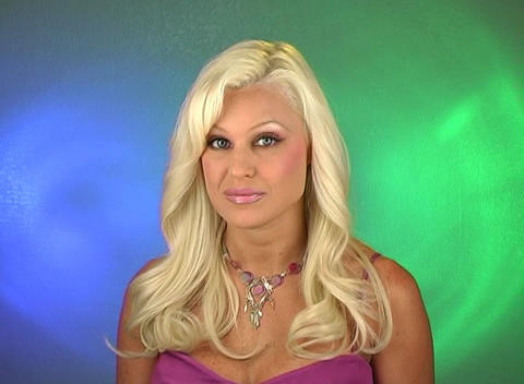 Beautiful Blonde Shrugs Her Shoulders Stock Video Footage