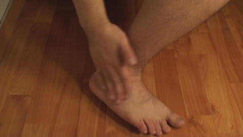 Man Massaging Ankle, Ankle Injury, Pain, Treatment Footage