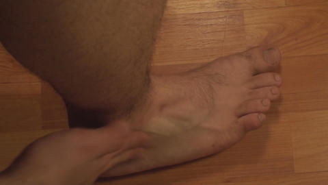 Man Massaging Ankle, Ankle Injury, Pain, Treatment Live Action