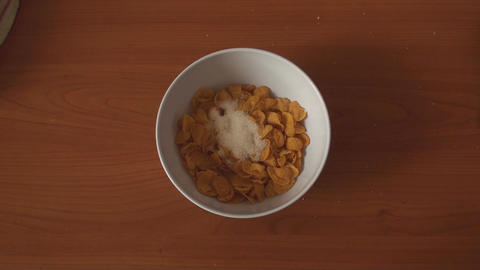 Adding Milk And Sugar Over An Bowl Of Cereals Footage