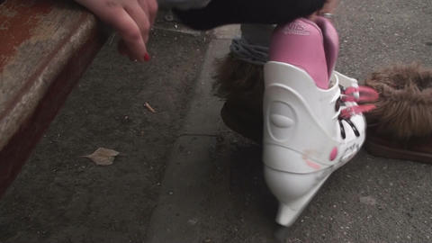 Young Woman Puts On The New Pair Of Ice Skates Footage