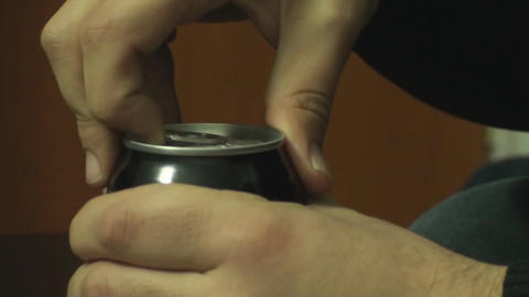 Macro Shot Of A Young Man Opening Up A Can Of Soda Footage
