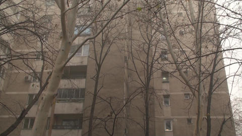 Pan Of An Old Apartment Building In The Mist stock footage