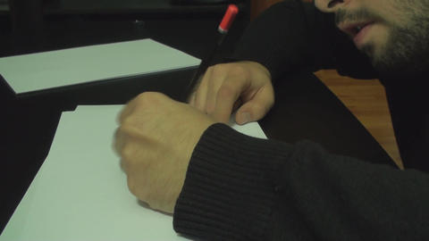 Young Man Drawing On Paper With A Pencil Side Shot Footage