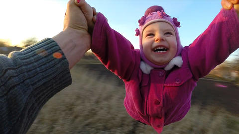 Slow Motion. Man Rotates His Little Daughter Outdo Footage