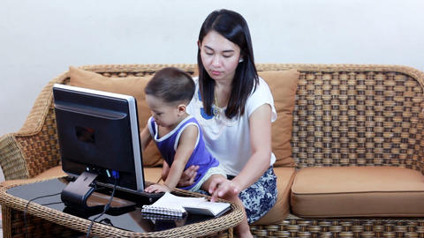 Asian Woman Playing Tablet Or Computer