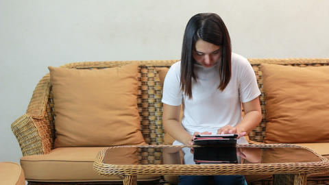 Asian Woman Playing Tablet Or Computer 1