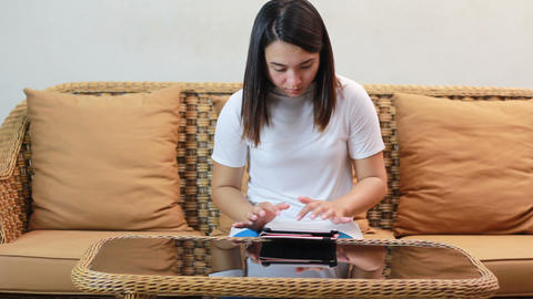 Asian Woman Playing Tablet Or Computer 2