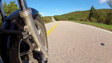 Low Angle POV Motorcycle Riding Forest Road 1 stock footage