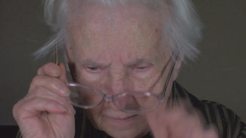 Old Lady Putting Her Glasses On Close Up-Shot Footage