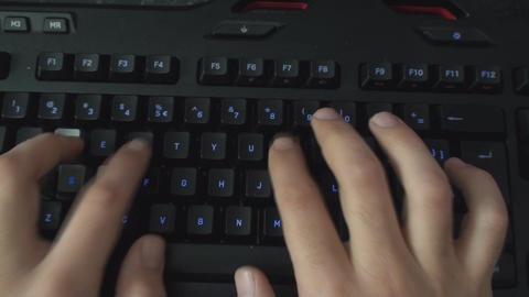 Detail Of Fingers Typing On A Illuminated Keyboard Live Action