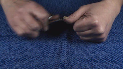 Detail Of Two Hands Nail Clipping Front-Shot Footage