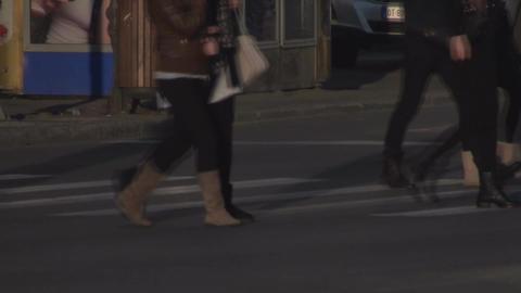 Pedestrians Crossing The Street Side-Shot Footage