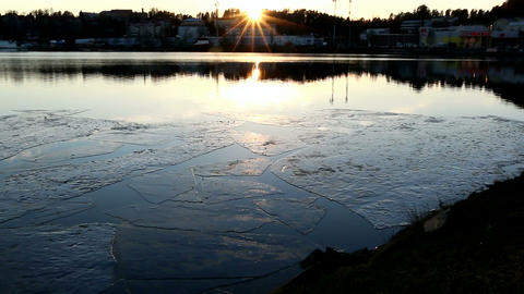 Ice Rafts At City Shore During Sunset stock footage