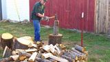 Mature Man Splitting Logs For Firewood stock footage