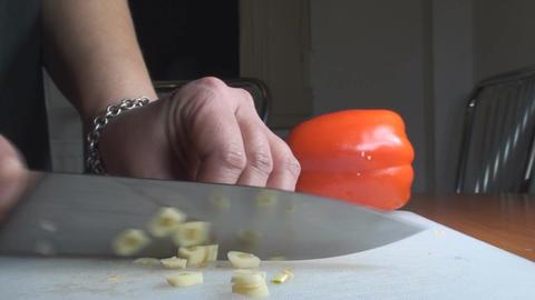 Chicken Stroganoff Slicing The Garlic Side-Shot stock footage