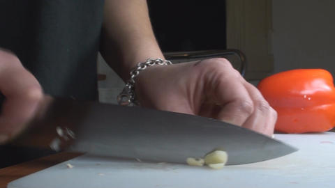 Chicken Stroganoff Slicing The Garlic Dolly-Shot stock footage