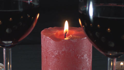 Big Red Candle And Two Glasses Of Wine Unfocused C Footage