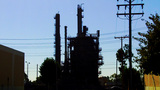 Oil Refining Tower And Electric Power Lines stock footage