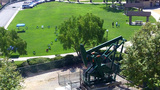 Oil Well Pump Next To City Park Zoom stock footage
