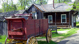Old West Frontier Gold Rush Era Wagon & House stock footage