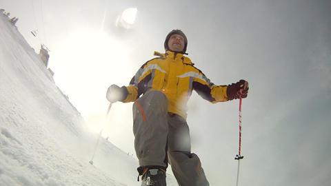 Alpine skier skiing short swings on ski slope on s Footage