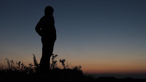 Silhouetted Man Standing In Sunset stock footage