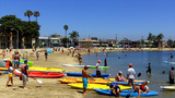 People In Kayaks On Crowded Beach stock footage