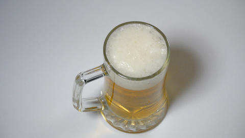 Glass Of Beer On A White Background stock footage