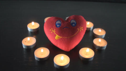 Heart Surrounded By Small Lit Candles Front-Shot Footage