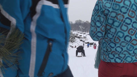 Kids Having Fun Sliding On A Slippery Slope Front- Footage