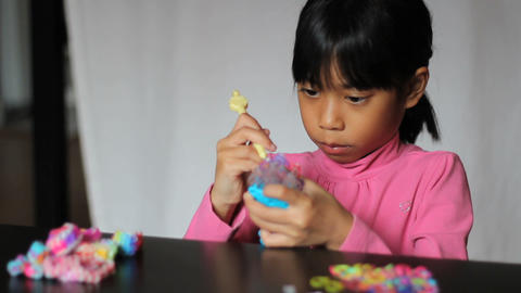 Asian Girl Using Rainbow Loom Footage