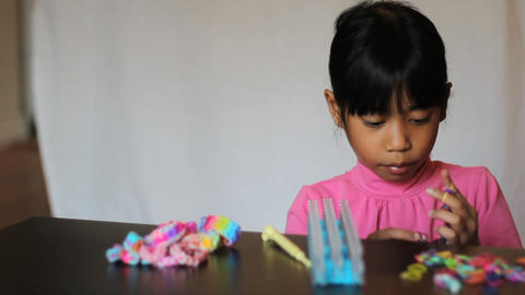 Cute Girl Shows Off Colorful Bracelet Made On Loom Footage