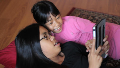 Girls Having Fun On New Digital Tablet Footage
