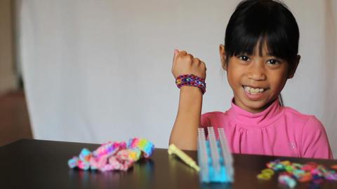 Little Girl Displays Color New Handmade Bracelet Footage