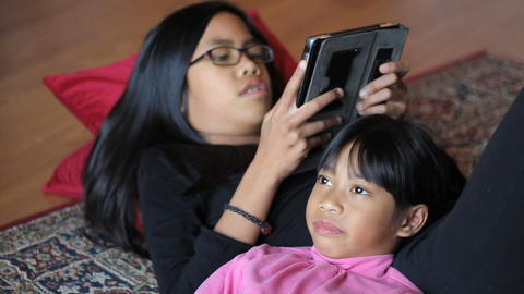 Sisters Have An Argument Using Digital Tablet Footage