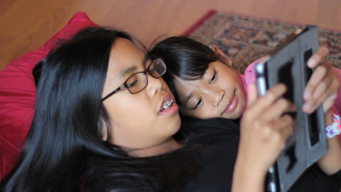Sisters Spend Time Together On New Digital Tablet Footage