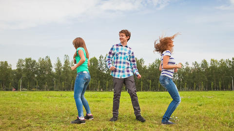 Teens Dancing in a Meadow Footage