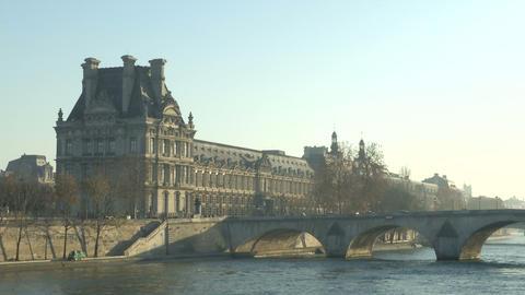 Louvre museum and bridge across the Seine river Live Action
