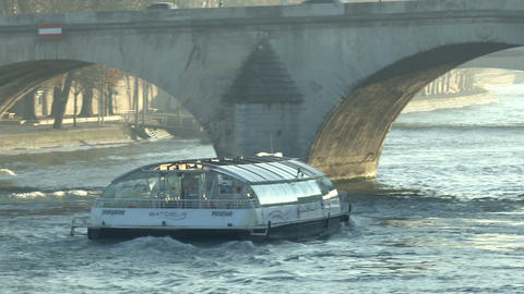 Boat Passing Underneath Bridge On The Seine River stock footage
