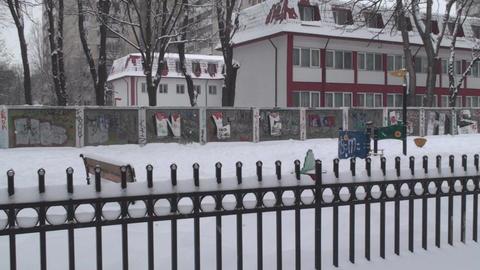 Deserted Amusement Park In A Snow Storm Pan-Shot Footage