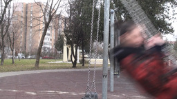Young Woman On A Swing Side-Shot stock footage