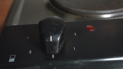 Hand Detail Of Buttons On Electrical Stove Live Action