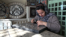 Veiled lady at work in Iran Footage