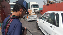 Crew guides cars off ferry in Iran Footage