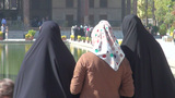 Veiled Ladies Look At Beautiful Palace In Isfahan, stock footage