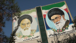 Imam Khomeini and Khamenei portrayed on wall in Ir Footage