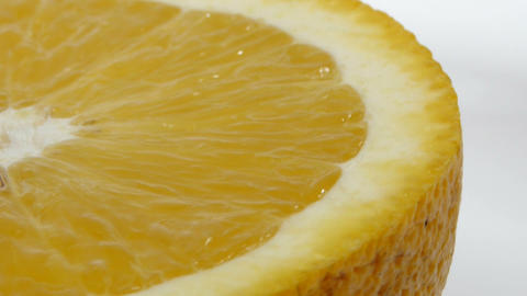 Slice of fresh orange isolated on white background Footage