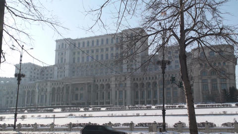 House Of Parliament In Bucharest Side-Shot With Tr stock footage