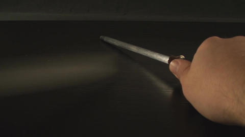 Hands Sharpening Knife Point Of View-Shot Footage